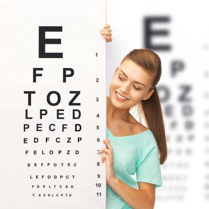 woman peaking around eye chart